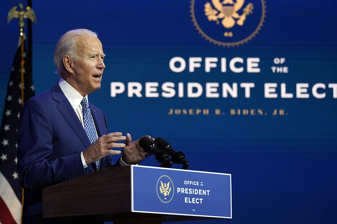 biden in front of podium and seal of the office of the president elect